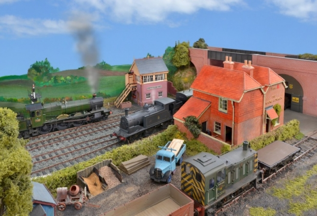 Ex-SR M7 passes an ex-GWR Manor by the East signal box