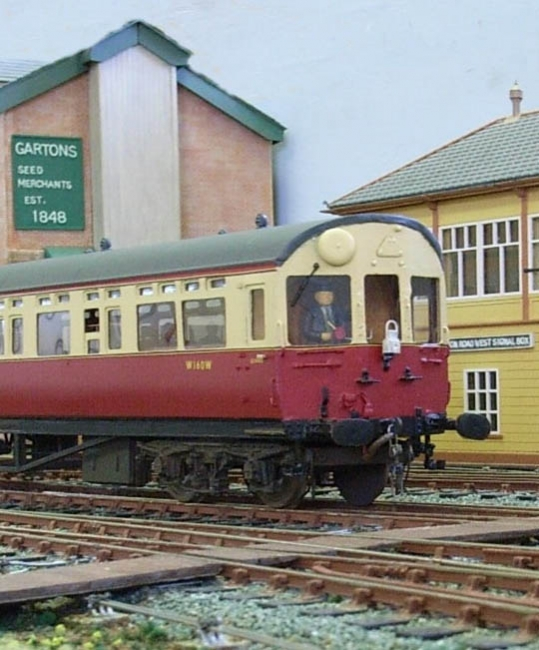 Autocoach in BR livery enters the station